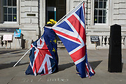 Brexit protest flags outside the Cabinet Office on Whitehall, the location of daily Brexit contingency planning meetings codenamed Yellowhammer, in government departments, on 19th August 2019, in London, England.
