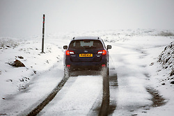 © Licensed to London News Pictures. 21/11/2018. Richmond UK. A car drives past Britains highest pub, the Tan Hill Inn that sits at 1732ft above sea level on the Pennine Way in North Yorkshire in heavy snow this morning. Photo credit: Andrew McCaren/LNP