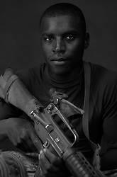Navy Corpsman Mack Talley, 20, Compton, California. Second Platoon, Kilo Company, 3rd Battalion, 1st Marine Regiment, 1st Marine Division, United States Navy, at the company's firm base in Hit, Iraq on Friday Sept. 23, 2005.