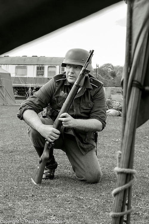 Members of 4 Kompanie Gro§deutschland take part in the first days battle re-enactment at Fort Paull. A reenactor crouches looking for a target <br /> <br />   03 May 2015<br />   Image © Paul David Drabble <br />   www.pauldaviddrabble.co.uk