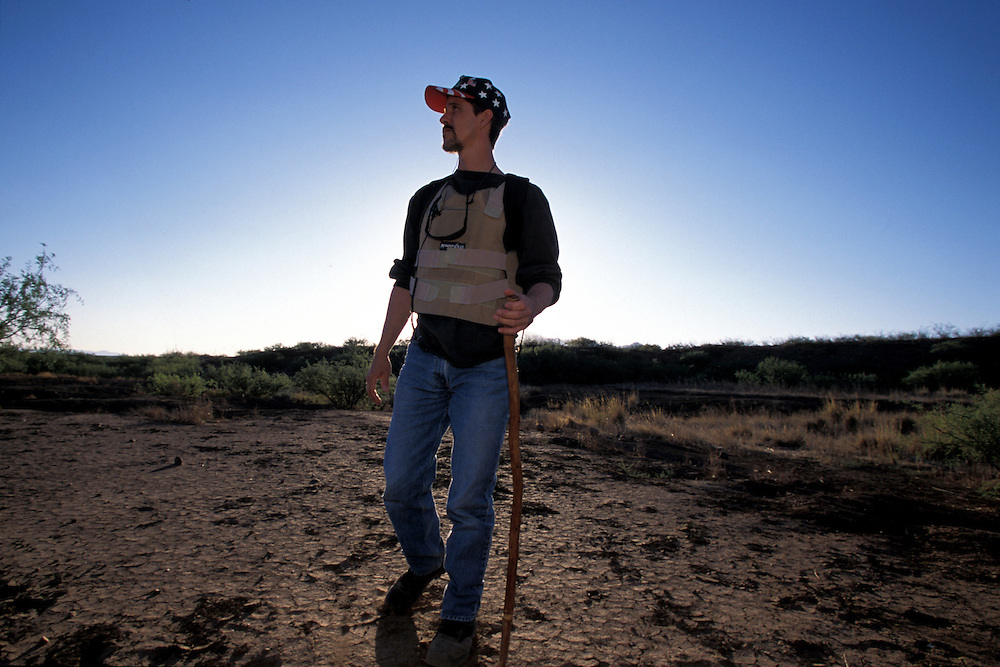 """Chris Simcox helped found the Minutemen, a group of anti illegal immigration advocates who spend time along the U.S.-Mexico border patrolling for undocumented migrants. Simcox helped launch the organization by issuing a """"Call to Arms"""" in the local Tombstone Tumbleweed publication he owned in Tombstone, Arizona. Please contact Todd Bigelow directly with your licensing requests."""