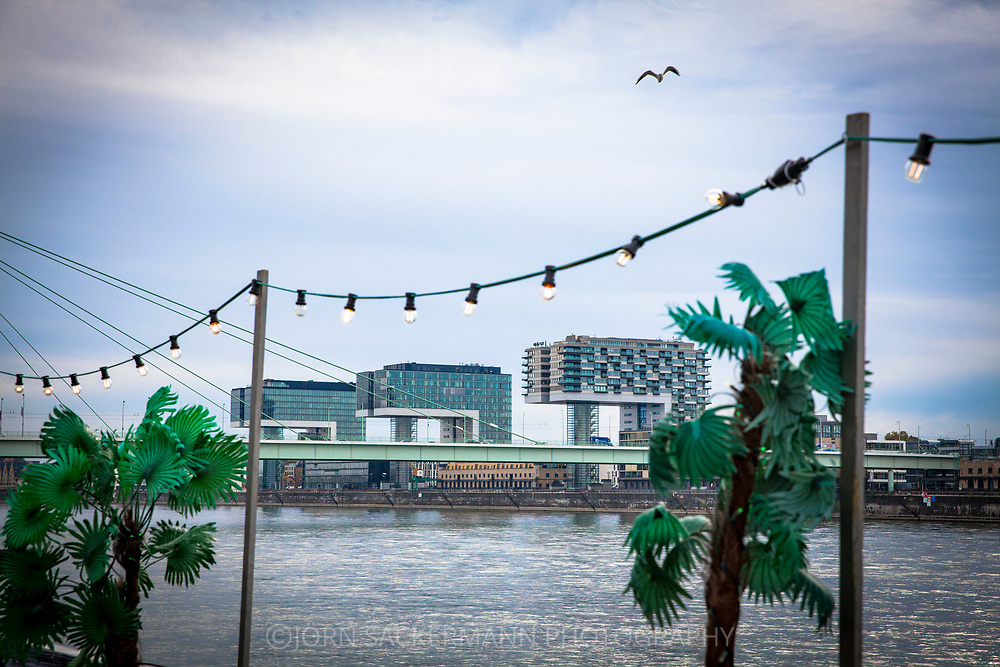 view from the banks of the river Rhine in the district Deutz to the Severins bridge and the Crane Houses at Rheinau harbor, Cologne, Germany.<br /> <br /> Blick vom Rheinufer in Deutz zur Severinsbruecke und den Kranhaeusern im Rheinauhafen, Koeln, Deutschland.