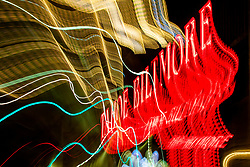 """""""Tahoe Lights 5"""" - Photograph taken at the Lake Tahoe northern state line casinos. The look was achieved by shooting a handheld long exposure and zooming the lens during the exposure."""