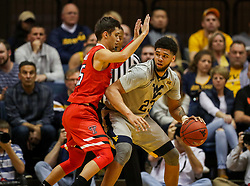 Feb 26, 2018; Morgantown, WV, USA; West Virginia Mountaineers forward Esa Ahmad (23) looks to make a move in the lane during the first half against the Texas Tech Red Raiders at WVU Coliseum. Mandatory Credit: Ben Queen-USA TODAY Sports