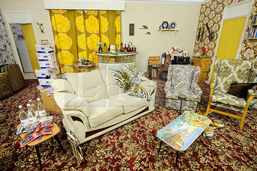 © Licensed to London News Pictures. 15/03/2013 London, UK.  A view of a replica of Dell Boy's famous Peckham flat living room at the Ideal Home Show 2013. The Trotters Only Fools and Horses residence has been given a modern makeover by Celebrity designer George Clarke. .Photo credit : Simon Jacobs/LNP