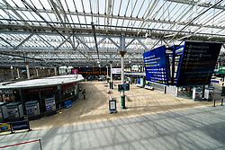 Edinburgh, Scotland, UK. 8 April 2020. Images from Edinburgh during the continuing Coronavirus lockdown. Pictured; Interior of a deserted concourse at Waverley station. Iain Masterton/Alamy Live News.