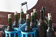 Transporting bottles in a carrying basket. Chateau la Grace Dieu les Menuts, Saint Emilion, Bordeaux, France