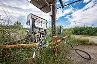A pair of old abandoned gas pumps outside of New Orleans near Shell Beach.