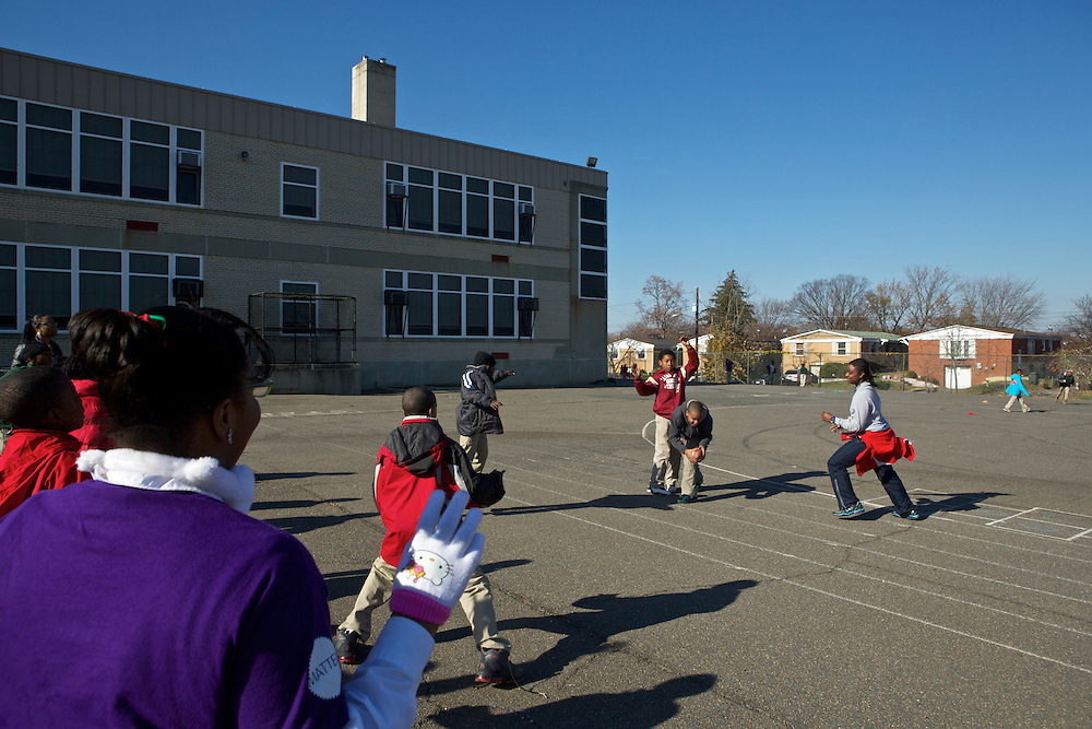 Children play during recess at Adelaide Davis Elementary School on Nov. 26, 2012 in Washington, D.C. Last week DCPS Chancellor Kaya Henderson proposed closing 20 under-enrolled schools in the District. Davis Elementary is one of 20 schools in the DCPS system included in the school closure proposal. ..CREDIT: Lexey Swall for The Wall Street Journal.DCSCHOOLS