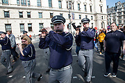 Livingston True Blues Flute Band from Scotland play as thousands of Leave supporters gathered in Parliament Square to protest against the delay to Brexit, on the day the UK had been due to leave the EU on 29th March 2019 in London, United Kingdom. As parliament debated and voted inside the commons, rejecting the Withdrawal Agreement again, outside in Westminster various groups of demonstrators including the Yellow Jackets, Leave Means Leave supporters and the Democratic Football Lads Alliance, gathered to voice their wish to leave the European Union, and their frustration that Brexit is not being delivered, waving Union flags and Believe in Britain placards.
