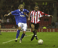 Photo. Glyn Thomas.<br /> Sunderland v Birmingham. FA Cup fifth round.<br /> Stadium of Light, Sunderland. 14/02/2004.<br /> Birmingham's Robbie Savage (L) battles for the ball with Sunderland's Jeff Whitley.