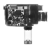 A Minolta Auto Zoom 8mm motion picture camera is shown in X-ray.