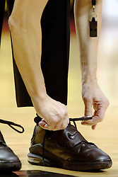 06 December 2006: Official ties her shoes. In a non-conference game, the Cardinals of Ball State visited the Redbirds home at Redbird Arena in Normal Illinois on the campus of Illinois State University.<br />  This image available for EDITORIAL USE ONLY. A release may be required. Additional information by contacting alook at alanlook.com