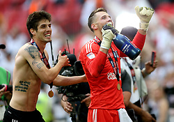 Fulham's Lucas Piazon (left) and Marcus Bettinelli celebrate after the final whistle during the Sky Bet Championship Final at Wembley Stadium