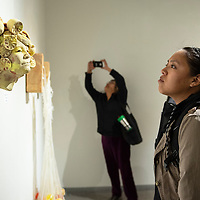 Andrea Begay, a ceramics student at the University of New Mexico Gallup looks at a piece by ceramic sculptor Randi O'Brien, Monday, March 4, at the Ingham Chapman Gallery  where her show Cultivating Essentia opened following an artist talk.