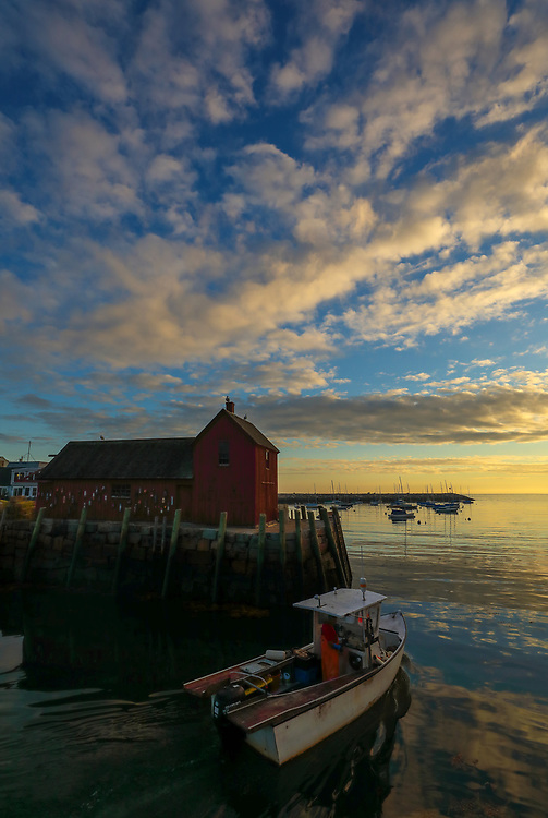New England harbor scenery of a fishing boat leaving safe harbor with Motif #1, a famous red fishing shack in Rockport, Massachusetts on Cape Ann. The photo captures the local fishing boat with the iconic landmark and a stunningly beautiful sunrise sky. The historic landmark is known throughout New England as Motif #1, so called because it is the most often painted building in America.<br /> <br /> This New England photo image of Rockport Motif Number 1 at sunrise is available as museum quality photography prints, canvas prints, acrylic prints, wood prints or metal prints. Prints may be framed and matted to the individual liking and decorating needs: <br /> <br /> https://juergen-roth.pixels.com/featured/leaving-safe-harbor-juergen-roth.html<br /> <br /> Good light and happy photo making!<br /> <br /> My best,<br /> <br /> Juergen<br /> Photo Prints & Licensing: http://www.rothgalleries.com<br /> Photo Blog: http://whereintheworldisjuergen.blogspot.com<br /> Instagram: https://www.instagram.com/rothgalleries<br /> Twitter: https://twitter.com/naturefineart<br /> Facebook: https://www.facebook.com