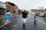 People seek cover after a siren indicating a second possible tornado nearby the area where one just struck in downtown Springfield, Mass. (AP Photo/Jessica Hill)