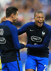 31 August 2017 -  FIFA World Cup Qualifying (Group A) - France v Netherlands - Kylian Mbappe of France (R) jokes with team mates during the warm up - Photo: Marc Atkins/Offside