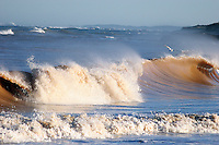 brown waves close to an estuary