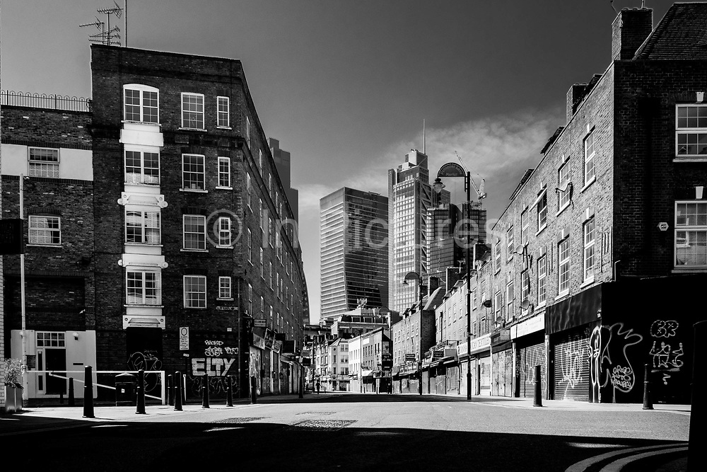 EDITORS NOTE: Image has been converted to black and white. Wentworth Street adjacent to Londons famous Petticoat Lane a famous market area of the city, is deserted due to lockdown as a result of the Coronavirus Pandemic on 16th April 2020 in London, United Kingdom. Coronavirus or Covid-19 is a new respiratory illness that has not previously been seen in humans. Much of Europe has been placed into lockdown, with stringent rules in place as part of a long term strategy, and in particular social distancing, and a stay at home policy.