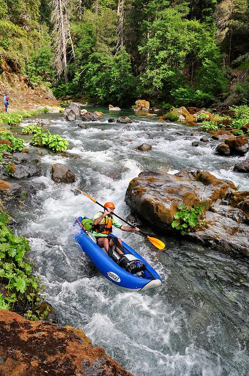 Paddling an inflatable kayak on Oregon's Chetco River.