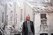 © Licensed to London News Pictures. 04/04/2012. London, UK.  Harry Allpress (93) the oldest of the Allpress family leans against a wall featuring an image of houses damaged in the Blitz.  Photo call and preview for the Imperial War Museum.s new A Family in Wartime exhibition. The exhibition features the life on the Home Front during the Second World War, explored through the eyes of one London based family, the Allpress.. Photo credit : Stephen SImpson/LNP