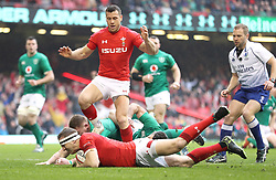 Wales' Hadleigh Parkes (centre bottom) scores his side's first try of the game during the Guinness Six Nations match at the Principality Stadium, Cardiff.