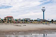 Tybee Island, Georgia, USA - July 28, 2021: People enjoy a summer afternoon at the beach on Tybee Island, located on the coast of Georgia near Savannah.
