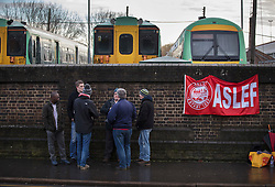 © Licensed to London News Pictures. 14/12/2016. London, UK. Workers man a picket line at the entrance to the Selhurst rail depot. Hundreds of thousands of rail passengers face a second day of a 3 day rail strike in an escalating dispute over the role of conductors and drivers. Photo credit: Peter Macdiarmid/LNP