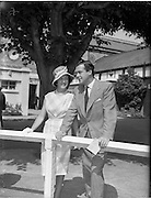 """02/08/1960<br /> 08/02/1960<br /> 02 August 1960<br /> R.D.S Horse Show Dublin (Tuesday). U.T.V.'s """"Robin Hood' Richard Greene and wife Mrs Beatriz Summers honeymooning in Dublin, pictured at the Horse Show."""