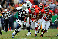 October 11, 2009:   Running back Tashard Choice #23 of the Dallas Cowboys rushes past defenders Mike Brown #30 and Brandon Flowers #24 of the Kansas City Chiefs for a 36-yard touchdown in the third quarter at Arrowhead Stadium in Kansas City, Missouri.  The Cowboys defeated the Chiefs in overtime 26-20...