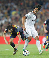 07-10-2012 VOETBAL: BARCELONA - REAL MADRID: BARCELONA<br /> Cesc Fabregas and Real Madrids Sami Khedira  // during during the Spanish Primera Division 7th round match between Barcelona FC and Real Madrid CF at Camp Nou, Barcelona<br /> ***NETHERLANDS ONLY***<br /> ©2012-FotoHoogendoorn.nl-Cesar Cebolla