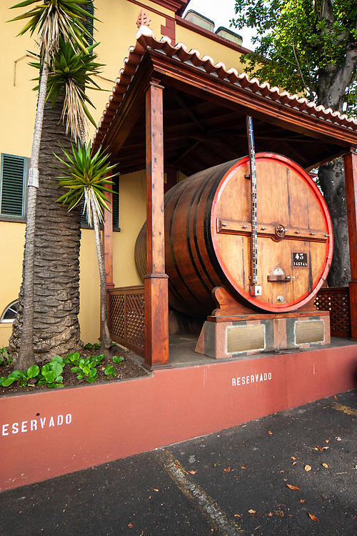 Madeira wine barrel in front of Madeira Wine Institute and Museum in Funchal, Madeira. The museum is a pedagogical approach to Madeira wine, its history, method of production, cooperage, export markets, instrumentation, and nostalgia.