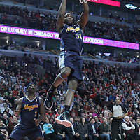 26 March 2012: Denver Nuggets forward Kenneth Faried (35) goes for the layup during the Denver Nuggets 108-91 victory over the Chicago Bulls at the United Center, Chicago, Illinois, USA. NOTE TO USER: User expressly acknowledges and agrees that, by downloading and or using this photograph, User is consenting to the terms and conditions of the Getty Images License Agreement. Mandatory Credit: 2012 NBAE (Photo by Chris Elise/NBAE via Getty Images)