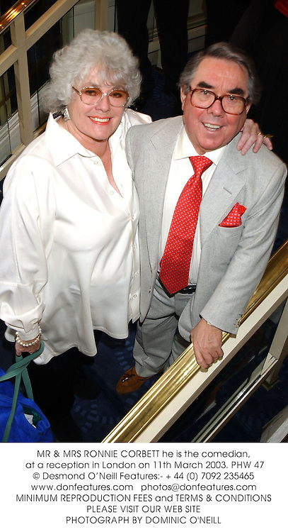 MR & MRS RONNIE CORBETT he is the comedian, at a reception in London on 11th March 2003.PHW 47