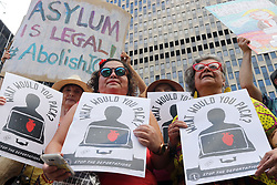 July 26, 2018 - New York City, New York, US - A coalition of immigration advocates rallied on the steps of the Department of Homeland Security (DHS) in lower Manhattan in support of migrants for a 'Deportee Suitcase Action' rally. Organizers are asking to think about one person 'someone you love' and imagine packing a suitcase for that person before they are deported. (Credit Image: © G. Ronald Lopez via ZUMA Wire)