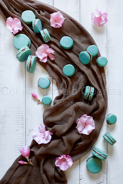 Top view of macaron cookies and pink oleander flowers