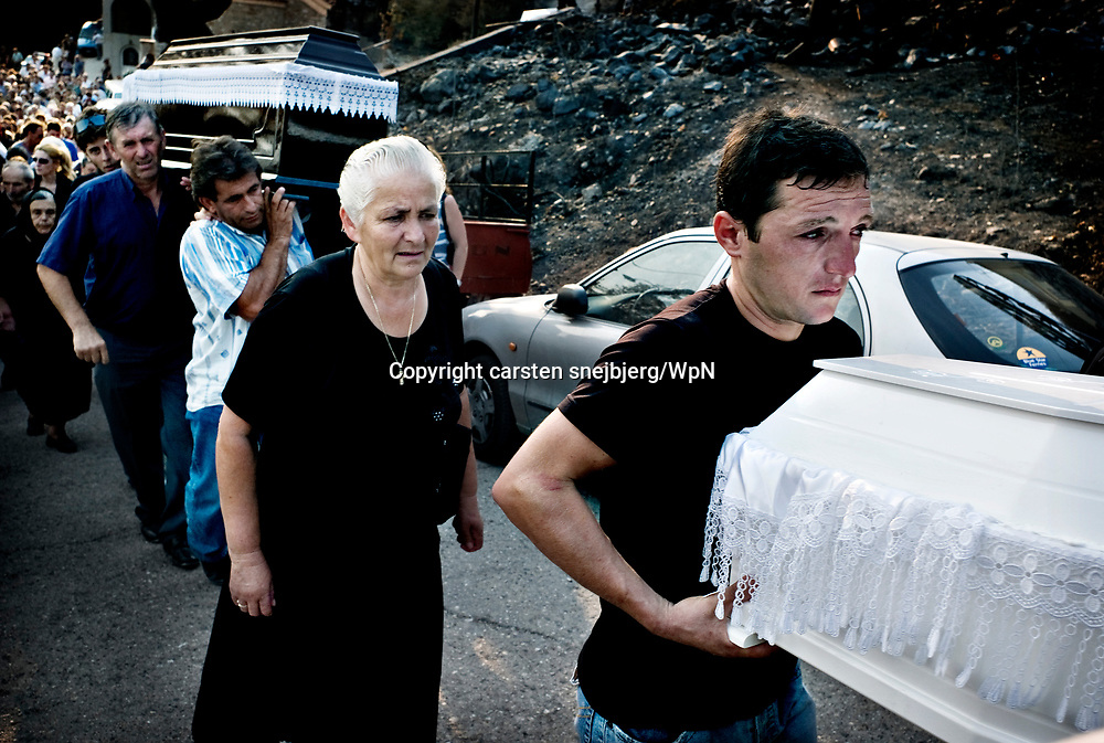 Funeral held for a 70-year-old woman and her two grand kids in Artemida, Greece, on Friday, Aug. 31, 2007