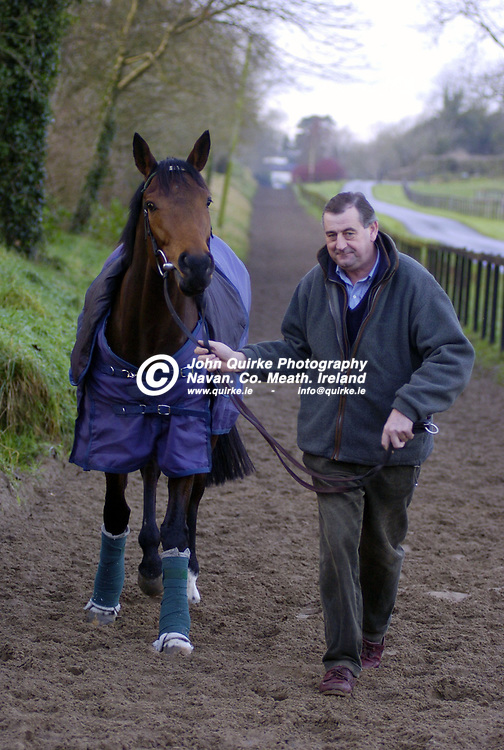 21/12/05 - Trainer Noel Meade photographed with his staff at his stables in Castletown.<br />Noel Meade photographed with 'Harchibald'.  <br />Photo:John Quirke/www.quirke.ie