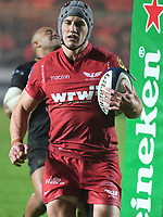 Rugby Union  - 2017 / 2018 European Champions Cup Pool 5. Llanelli Scarlets vs Bath<br /> <br /> Jonathan Davies of Llanelli Scarlets  with ball under one arm ,in heavy rain  at Parc Y Scarlets.<br /> <br /> COLORSPORT/WINSTON BYNORTH