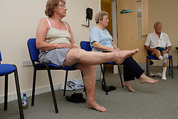 Older women and man taking part in a keep fit class,