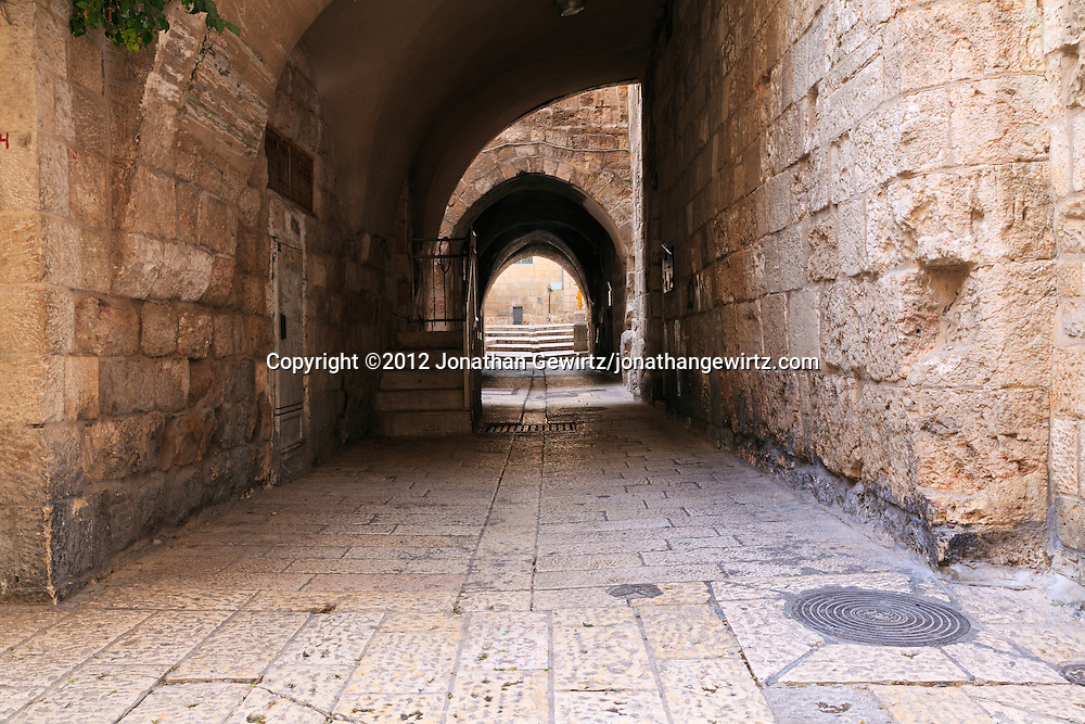 A narrow covered passageway into a courtyard in the Jewish Quarter of the Old City of Jerusalem. WATERMARKS WILL NOT APPEAR ON PRINTS OR LICENSED IMAGES.