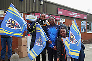 AFC Wimbledon fans waving flags during the EFL Sky Bet League 1 match between AFC Wimbledon and Bolton Wanderers at the Cherry Red Records Stadium, Kingston, England on 7 March 2020.
