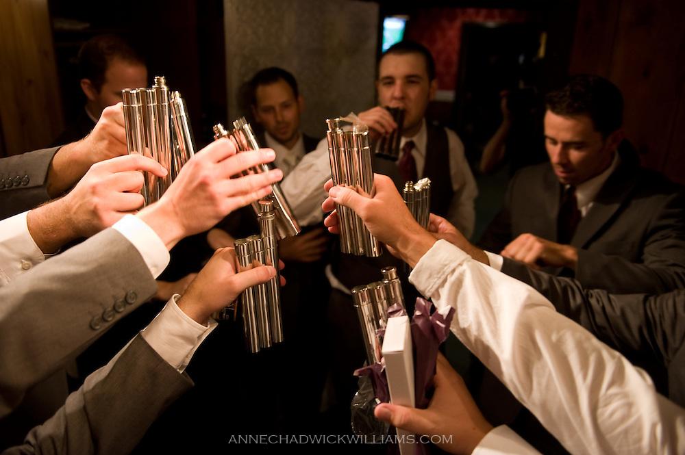 Groomsmen toast groom before wedding.