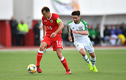 Gibraltar's Roy Chipolina (left) and Republic of Ireland 's Sean Maguire (right) battle for the ball during the UEFA Euro 2020 Qualifying, Group D match at the Victoria Stadium, Gibraltar.