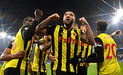 Watford's Troy Deeney (centre) celebrates scoring his side's fifth goal of the game with team-mates during the Premier League match at the Cardiff City Stadium.