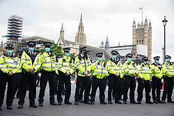Metropolitan Police officers prepare for the arrival in Parliament Square of climate activists from Extinction Rebellion attending a 'Carnival of Corruption' protest against the government's facilitation and funding of the fossil fuel industry on 3 September 2020 in London, United Kingdom. Extinction Rebellion activists are attending a series of September Rebellion protests around the UK to call on politicians to back the Climate and Ecological Emergency Bill (CEE Bill) which requires, among other measures, a serious plan to deal with the UK's share of emissions and to halt critical rises in global temperatures and for ordinary people to be involved in future environmental planning by means of a Citizens' Assembly.