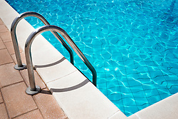 Sunlight reflected in swimming pool, Puglia, Italy