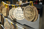 Wishes are written on small wooden placs then tied to the sides of the temple in hopes of them coming true.