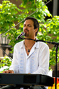 Scott Miller playing keyboard and singing for dancers. Grand Old Day Street Fair St Paul Minnesota USA